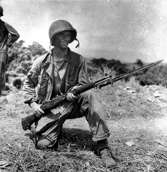 garand-jan26-1943-an-infantryman-is-on-guard-on-grassy-knoll-in-guadalcanal-1300.jpg